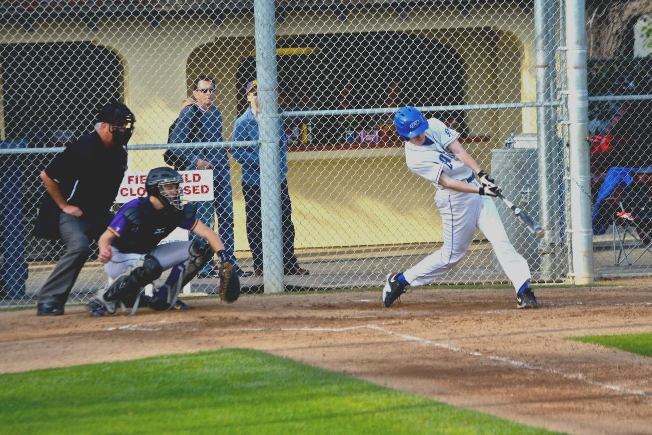Junior infielder Aidan Kelleher hits a ball back up the middle in a win over Monta Vista. After missing CCS last year, the baseball team is looking to bounce back this season. Photo by Kunal Pandit.