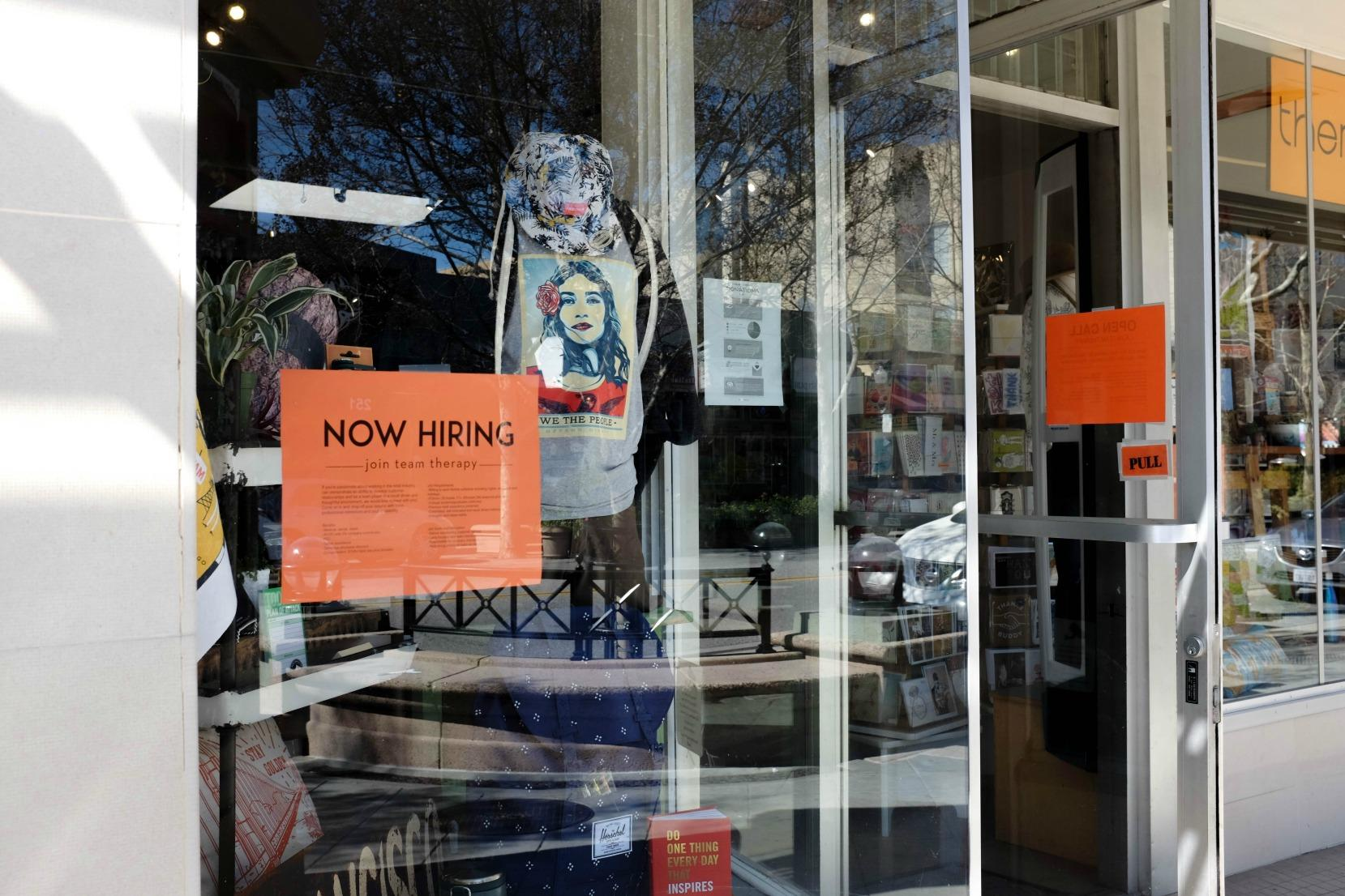 A sign on the window of boutique store Therapy in Mountain View reads