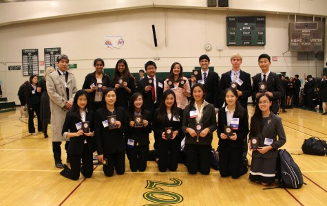 FBLA members who won awards in their events pose with co-advisor Derek Miyahara after the conference. Five club members qualified at the BSLC for the State Leadership Conference in April. Photo: Courtesy Michelle Deng