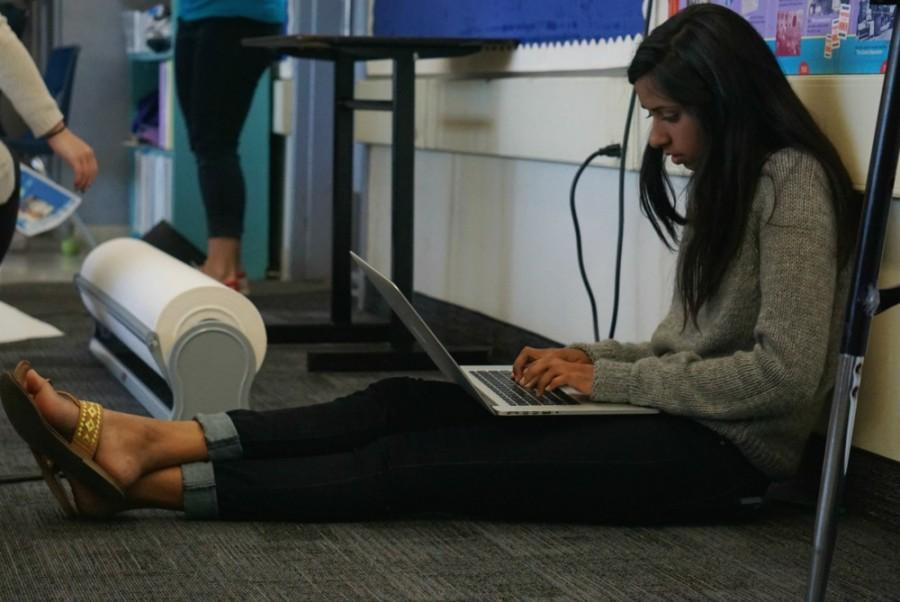 Junior Olivia Jain sits on the carpet installed in the 400 wing.  Photo by Allegra Maeso.