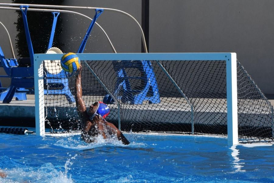 Junior+goalie+Vishnu+Ram+stops+a+shot.+The+boys+water+polo+team+has+done+well+to+start+the+season%2C+but+is+always+looking+to+improve.+Photo+by+Francesca+Fallow