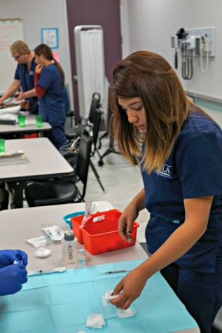 LAHS alumna Jessica Luna '09 completes work for her Medical Assistant program. Photo by Michael Sieffert.