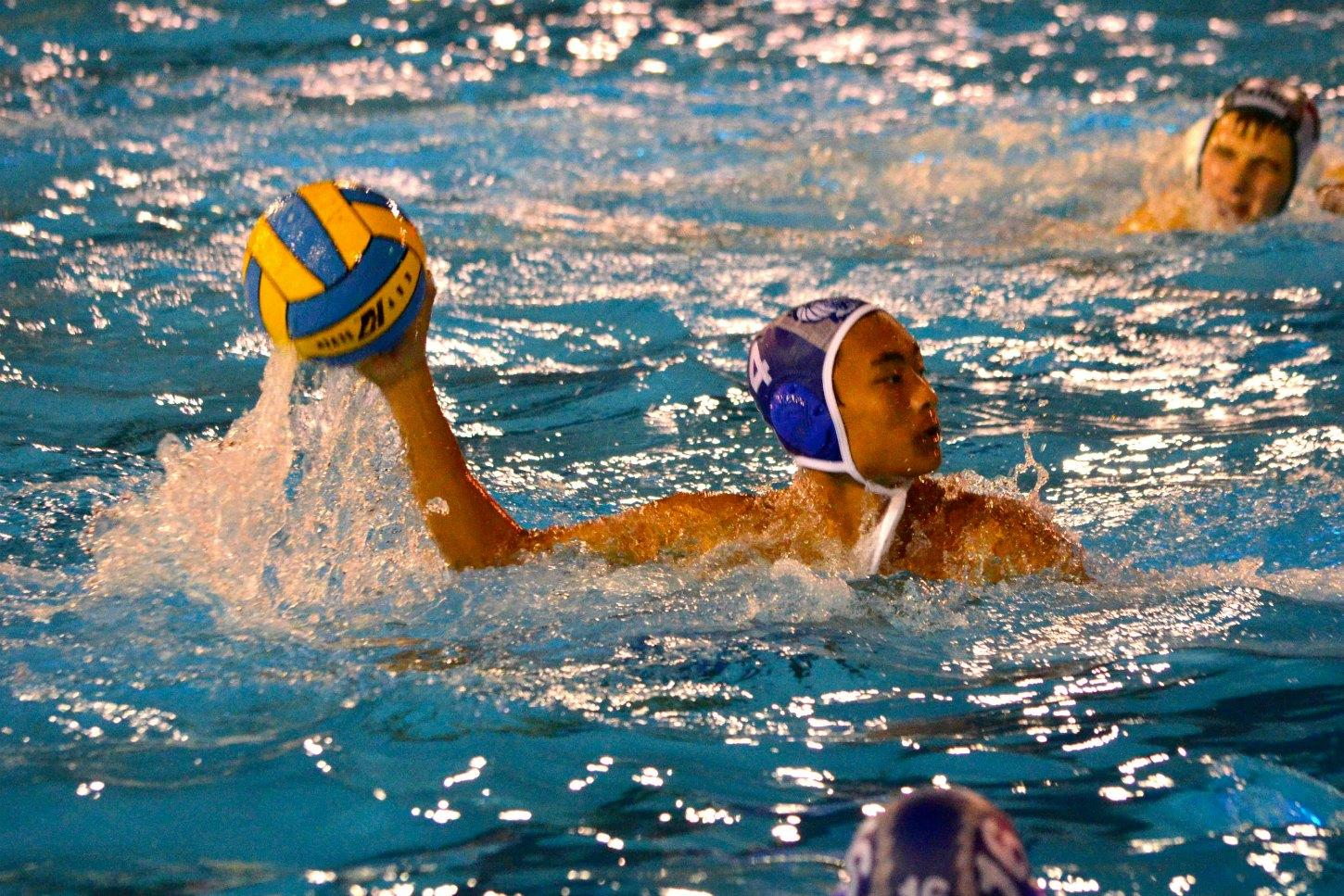 One of the members of the team honored at Senior Night, senior Patrick Fong prepares to make a pass. Photo by Kunal Pandit.