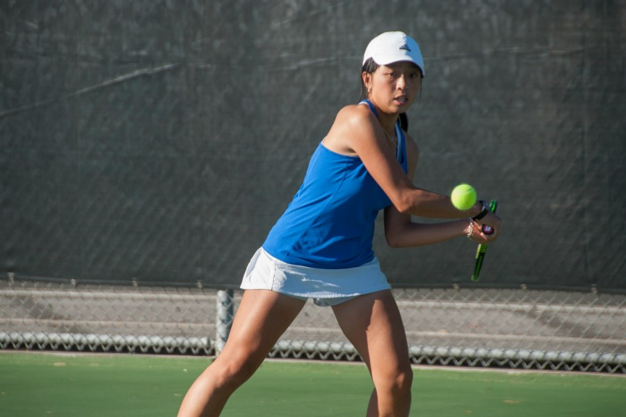 Freshman Celeste Tran prepares to hit the ball. Photo by Meilin Tsao.