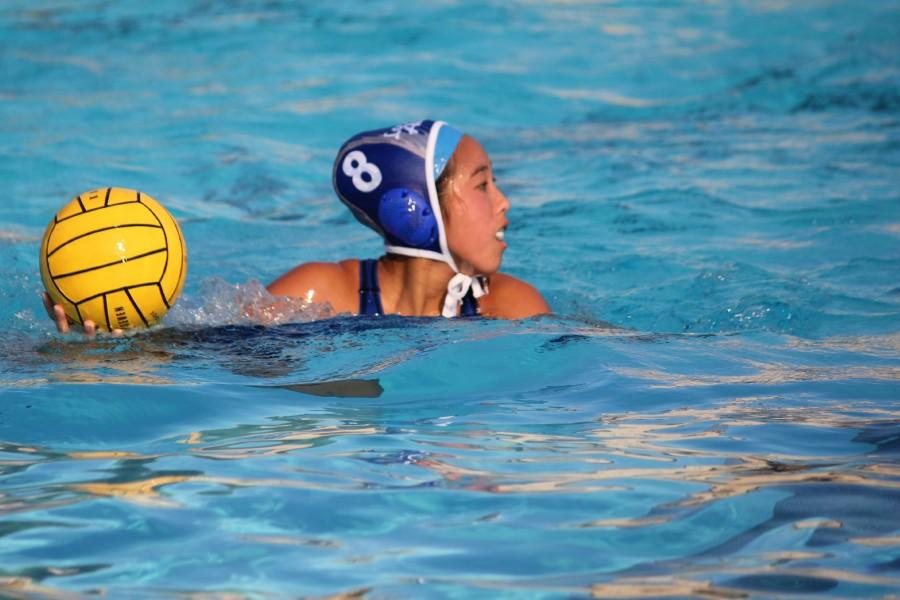 Junior Veronica Hsu looks to pass the ball. Photo by Rachel Lu.