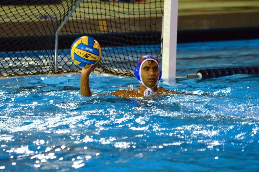 Junior Vishnu Ram looks to move the ball up the pool. Photo by Kunal Pandit.