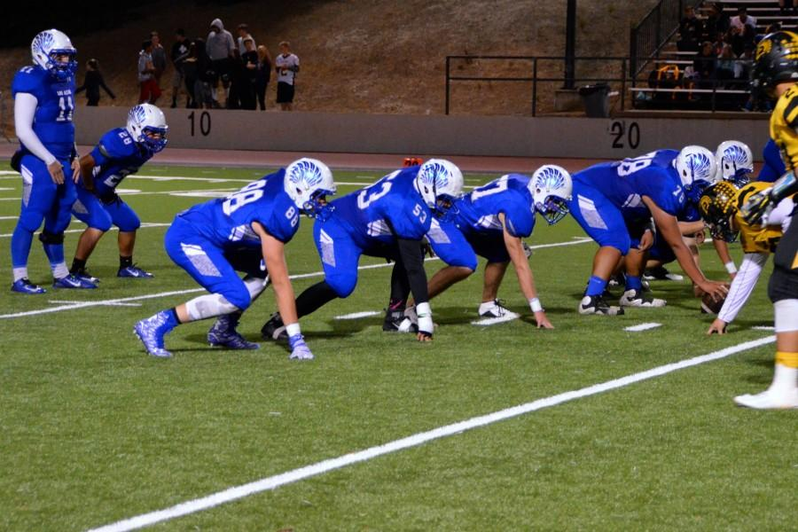The Eagles line up for their next play. Photo by Katie Klein.