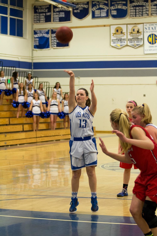 Senior Katie Munro takes a free throw. The girls basketball team is prime for a successful season. Talon File Photo.