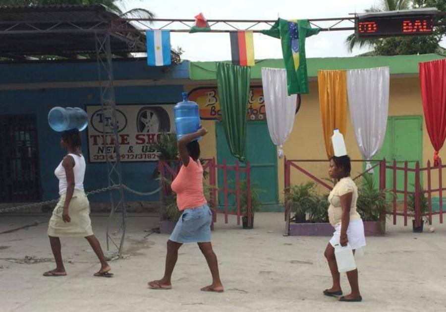 Women bring water home to their families in Petion-ville, Haiti. Photo courtesy Marie DeShetler.