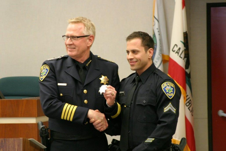 School Resource Officer Ryan Langone (right) is promoted to Agent status and shakes hands with Los Altos Police Chief Tuck Younis (left).  In September, Langone was appointed to the School Resource Officer position. Photo courtesy Ryan Langone.
