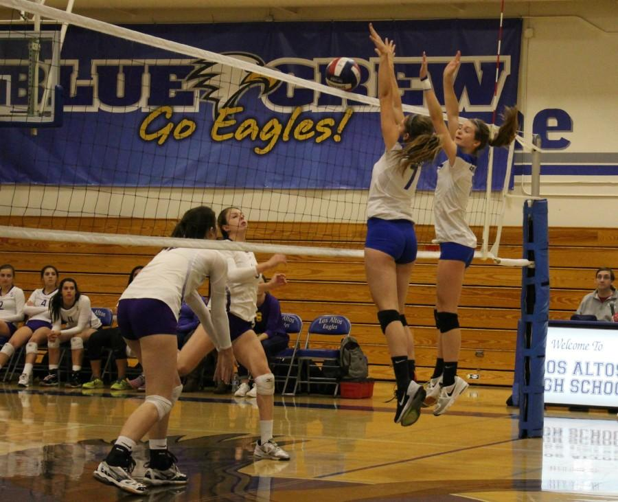 Juniors Katherine Mumm and  Lauren Limbach try to block the ball. Photo by Allegra Maeso.