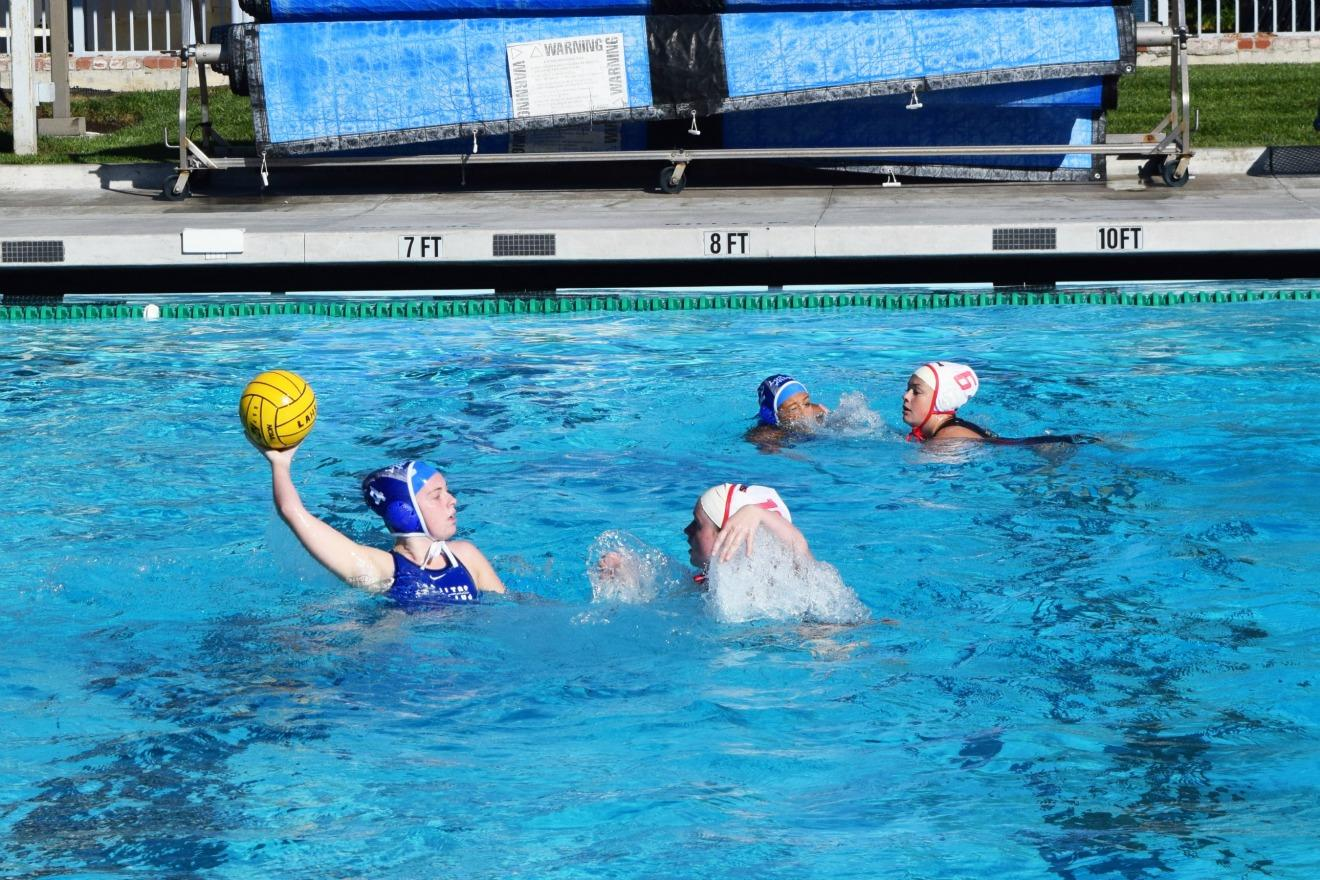 Junior Claire Bourquin carries the ball. The girls water polo team has high expectations for CCS. Photo by Francesca Fallow.