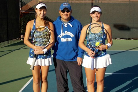 Seniors Juliette Martin and Carina Burdick (left and right) pose for a photo with head coach Hung Nguyen (center) after winning the CCS doubles title. The win was the pinnacle of the girls' four-year varsity tennis careers. Photo courtesy of Carina Burdick.