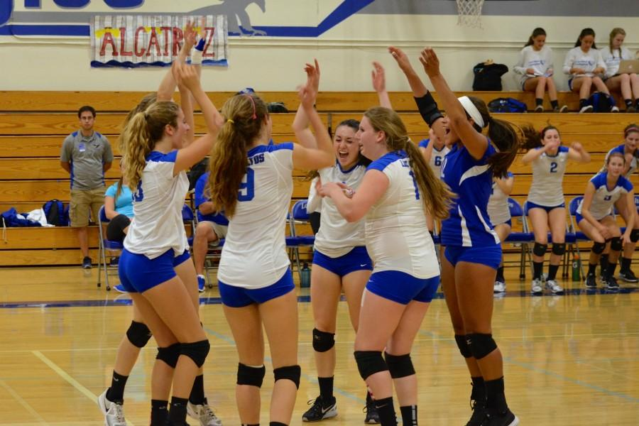 The+girls+volleyball+team+celebrates+an+ace.+Despite+losing+many+of+their+leaders+to+graduation+and+injury%2C+the+Eagles+came+together+to+win+their+second+straight+Golden+Gate+Classic.+Photo+by+Kunal+Pandit.