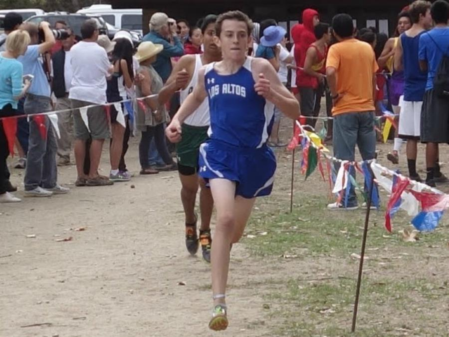 Freshman Owen MacKenzie runs for the varsity boys cross country team. While being a freshman on a varsity team can be challenging, it provides a great experience for top young athletes. Photo by Josh Kirshenbaum.