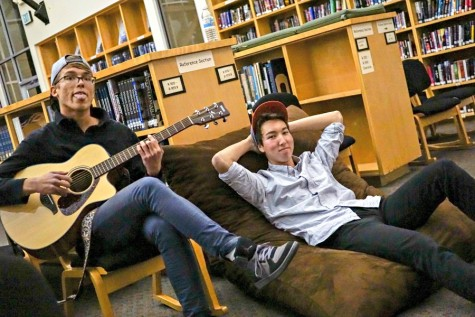 Viktor Niemiec (left) and Derek Mark (right) pose for the camera in the library. Photo by Michael Sieffert.