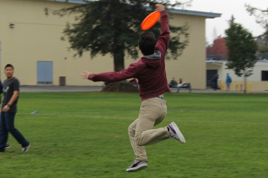 Students play ultimate frisbee during lunchtime. Recreational sports like ultimate frisbee are beneficial to students both as a way to relieve energy and as a way to provide peace of mind to often stressed out students.