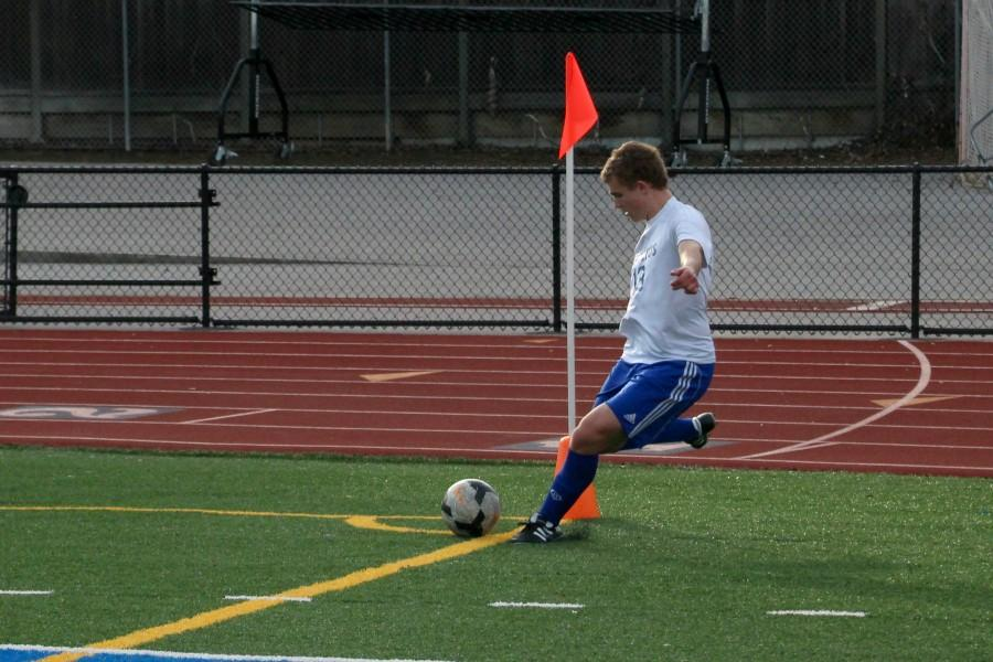 Junior Albin Mollerstedt takes a corner kick. Photo by Josh Kirshenbaum.