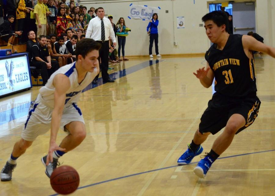 Junior Tommy Andrews drives toward the basket. Photo by Kunal Pandit.