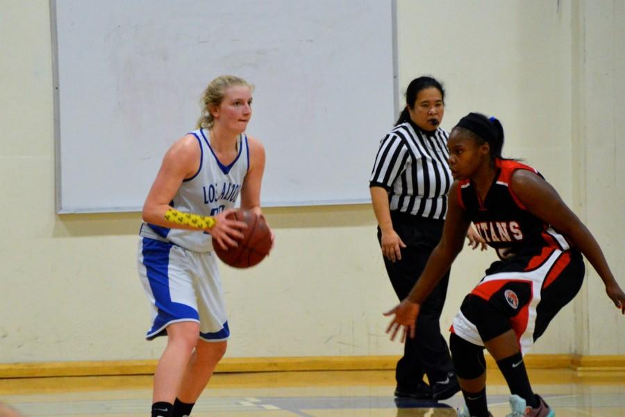 Senior+Rachel+Glein+looks+to+pass+the+ball.+Photo+by+Katie+Klein.