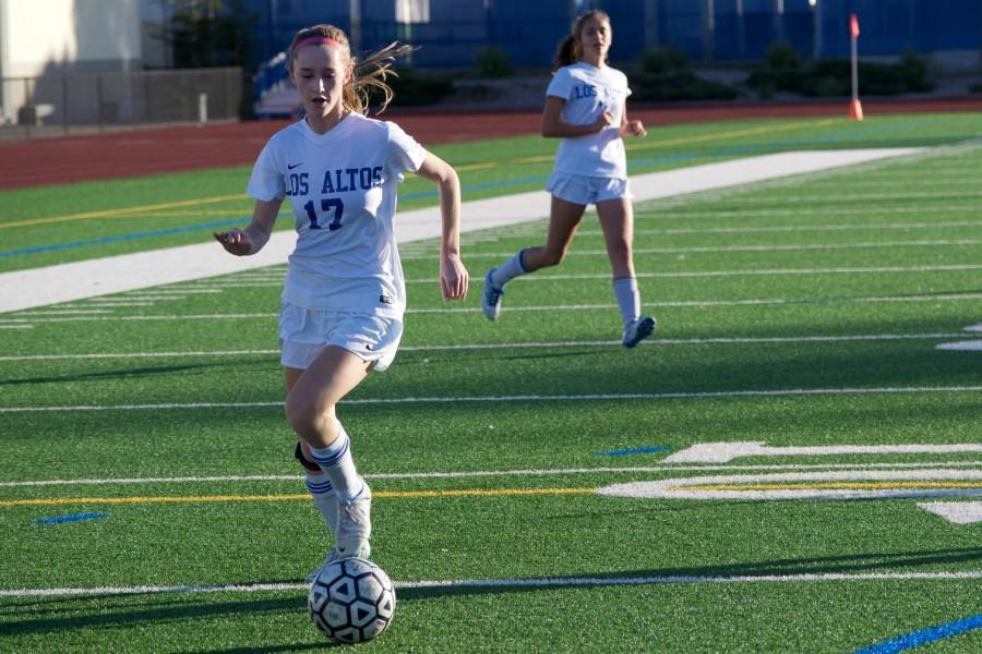 Senior Stephanie Kouvelas dribbles the ball down the field. Photo by Francesca Fallow.