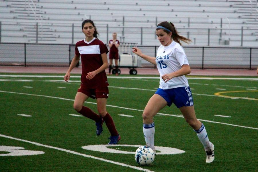 Freshman Hannah Calhoun dribbles the ball. Photo by Katie Klein.