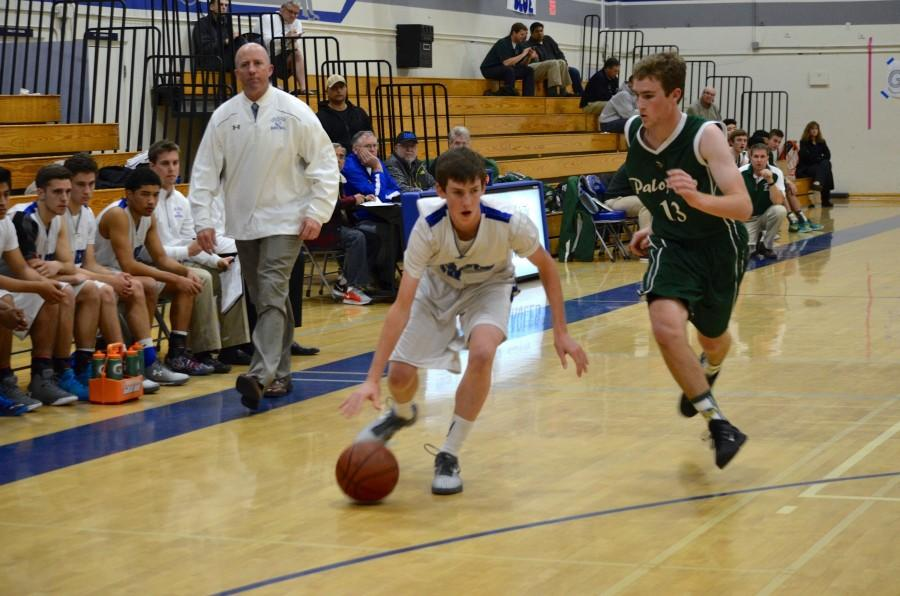 Sophomore Matt Eberle dribbles the ball past a defender. Photo by Kunal Pandit.