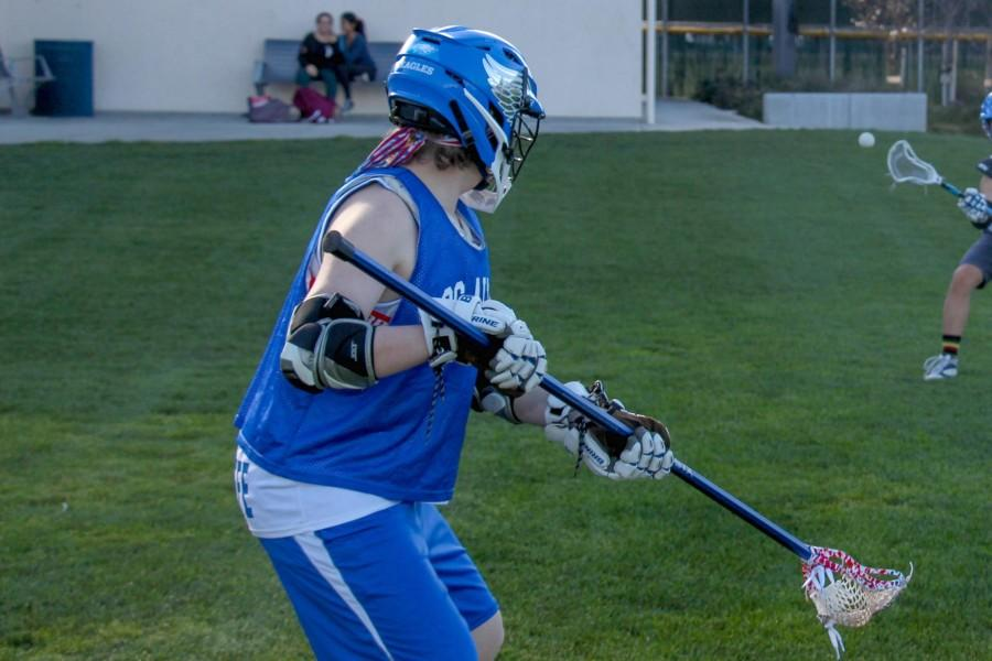 Junior Brendan Radcliffe catches the ball in practice. The lacrosse team hopes that by being fundamentally sound, it will have a successful season. Photo by Michael Sieffert.