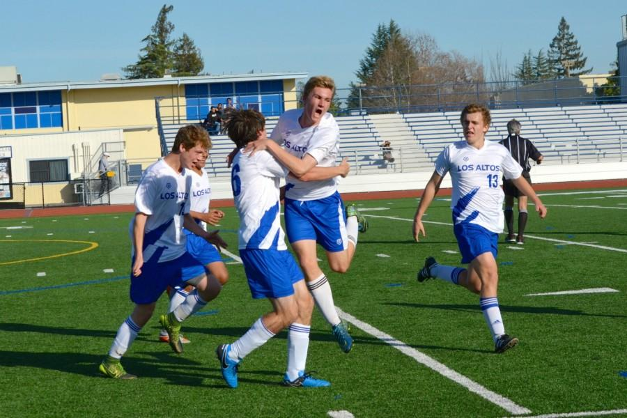 The boys soccer team celebrates a goal in its CCS first-round win over Westmoor. After an undefeated season, the team will move up to the De Anza League next year. Photo by Kunal Pandit.