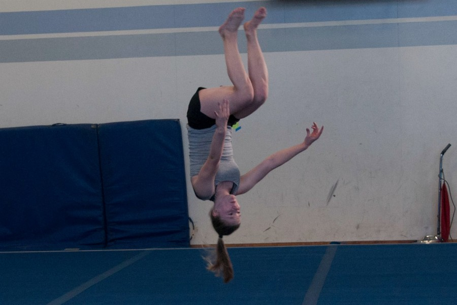 Freshman Roosa Uusitalo does a flip. Despite a lack of training space and time, the gymnastics team is ready for the upcoming season. Photo by Meilin Tsao.