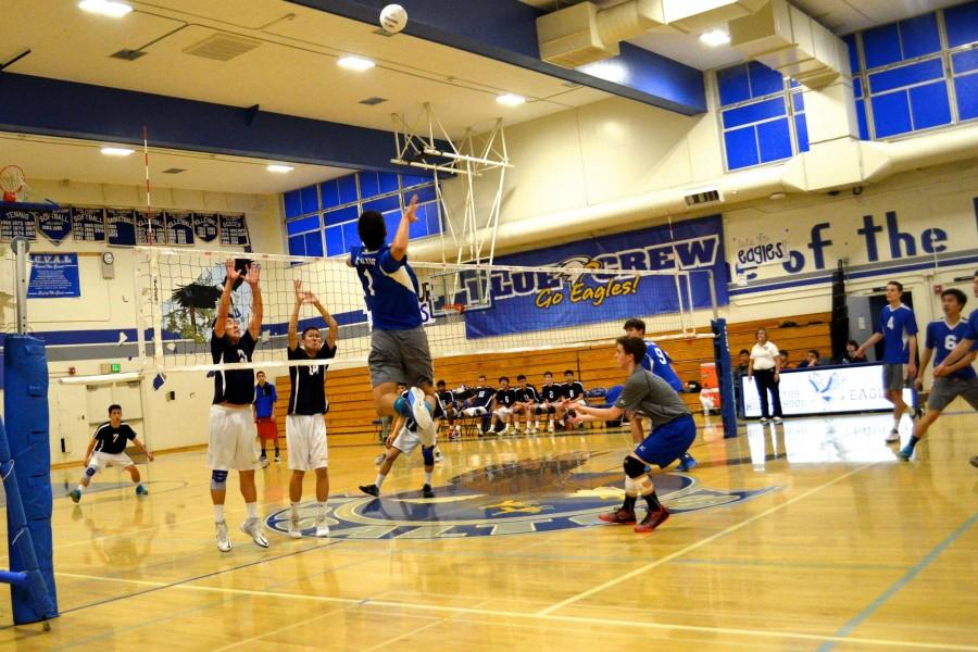 Senior Nathan Smith jumps up to spike the ball. Photo by Kunal Pandit.