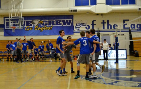 The boys volleyball team celebrates after the game. Photo by Kunal Pandit.