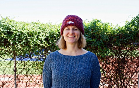 Geometry and engineering teacher Teresa Dunlap proudly sports her Broncos beanie. Dunlap has supported the Broncos since her childhood, and recently wrote a guest commentary for the Denver Post about her favorite team and Peyton Manning. Photo by Kimia Shahidi.