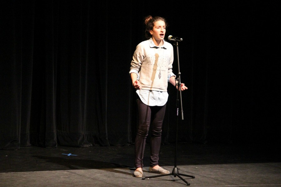 Freshman Yalda Khodadad performs her poem. Photo by Rachel Lu.