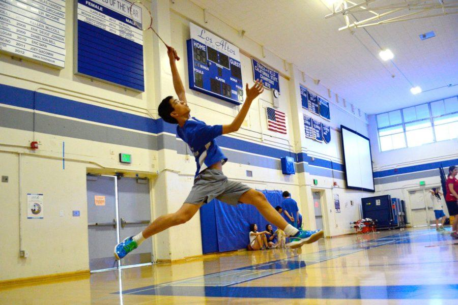 Junior Henry Ma stretches to hit the shuttlecock. The badminton team has turned in a solid season so far. Photo by Kunal Pandit.