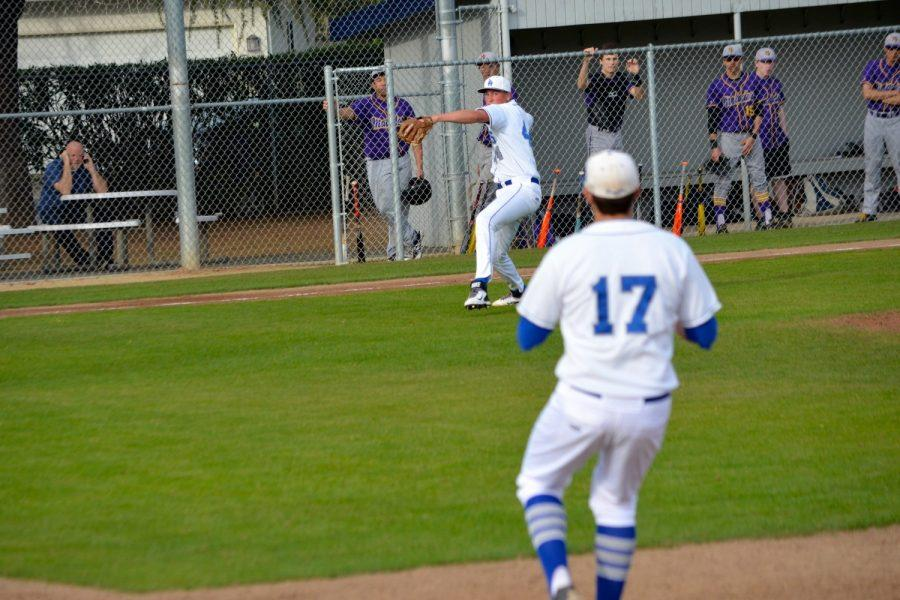 Sophomore Alex Reelfs throws to first. The baseball team is over .500 and looking to make a run in CCS. Photo by Kunal Pandit.