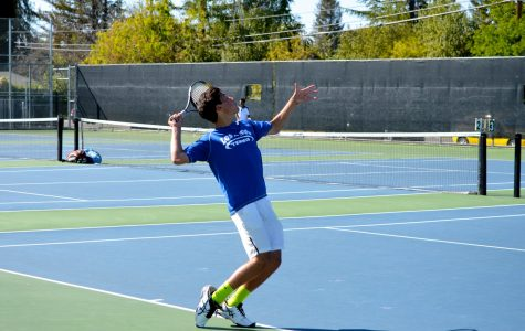 Junior Alec Jenab winds up to serve in practice. Despite a few tough losses, the boys tennis team boasts a 7-4 record and has SCVAL championships in its sights. Photo by Kunal Pandit.