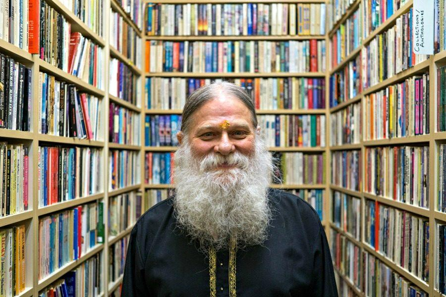 Hotranatha Ajaya, owner of Book Buyers on Castro Street, in one of the aisles of his bookstore. Ajaya began his life in a strict, Christian fundamentalist family, but later converted to Hinduism, which has grown to become a key aspect of his life. Photo by Michael Sieffert.