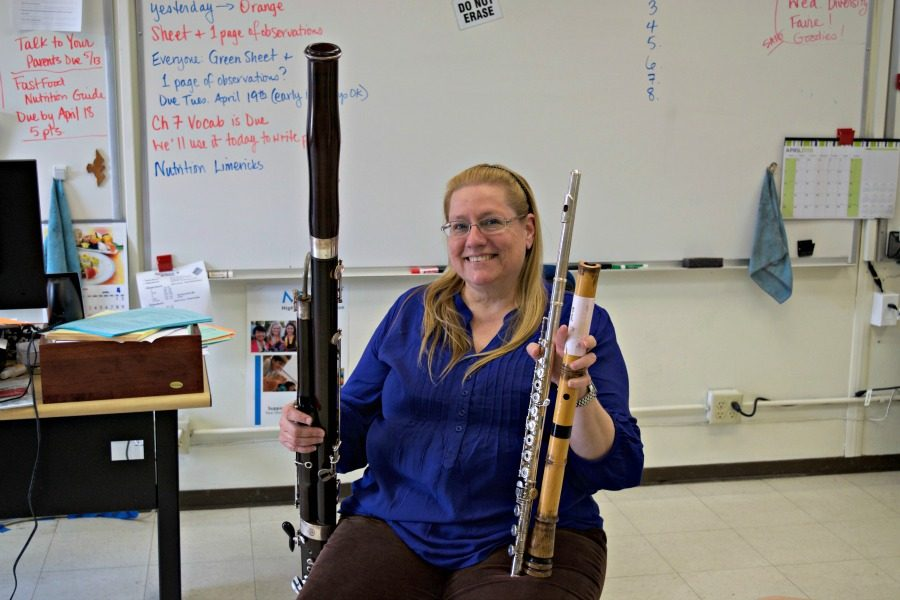 Health+teacher+Vickie+Christensen+smiles+with+just+a+few+of+the+20+musical+instruments+she+can+play%3A+her+bassoon%2C+flute+and+shakuhachi.+Christensen+took+interest+in+music+at+a+young+age%2C+and+she+is+currently+a+member+of+the+South+Bay+Philharmonic.+Photo+by+Francesca+Fallow.+