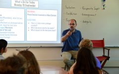 English teacher Robert Barker teaches the New Media Literacy class to students in room 401. Photo by Katie Klein.