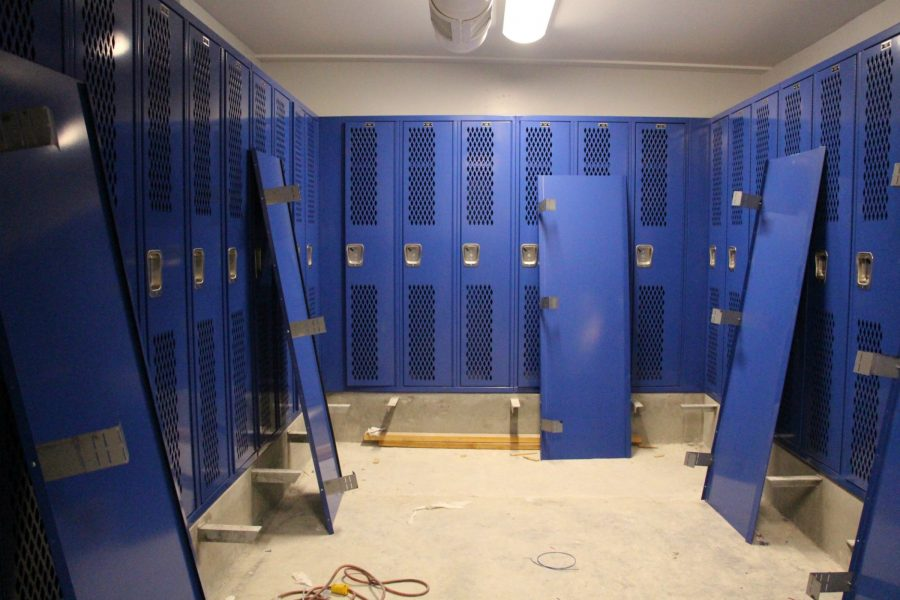New locker rooms will be completed between October 24 and October 31. Since school started, students and athletes have used the portables behind the large gym. Photo by Emily Aronovitz.