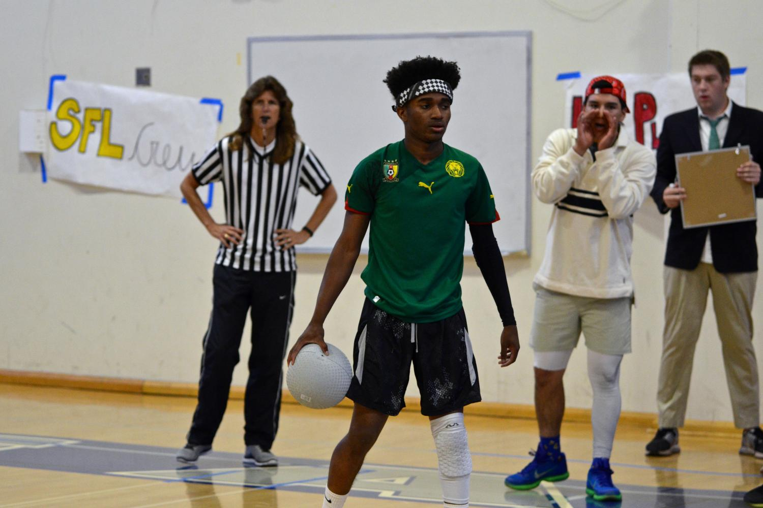 Goodwill Hunters senior Ahmad Washington , with teammate senior Max Higareda cheering him on in the background, gears up to throw against the Globo Gym Purple Cobras in the championship match.