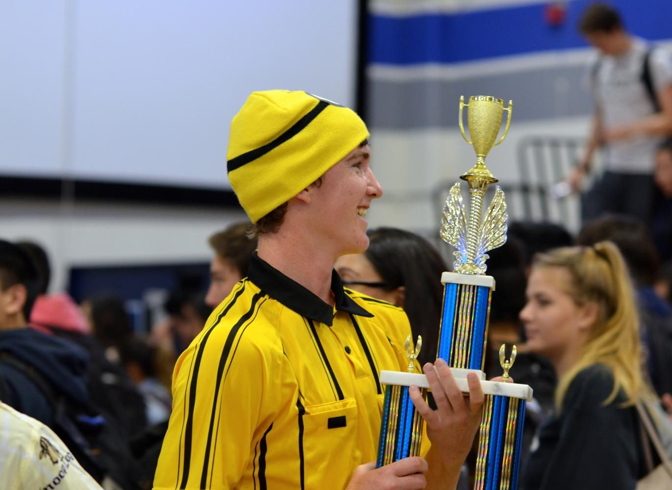Goodwill Hunters' senior Aidan Kelleher holds the championship trophy after the Hunters' triumph over the Globo Purple Gym Cobras.