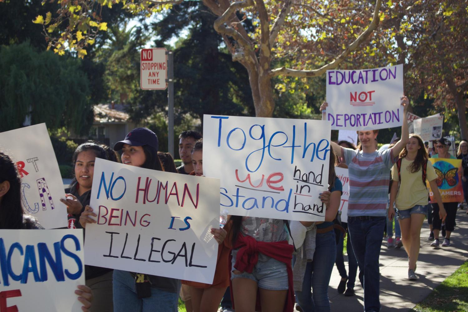 Students held signs and chanted as they marched to Eagle Park in Tuesday's protest of the DACA repeal.