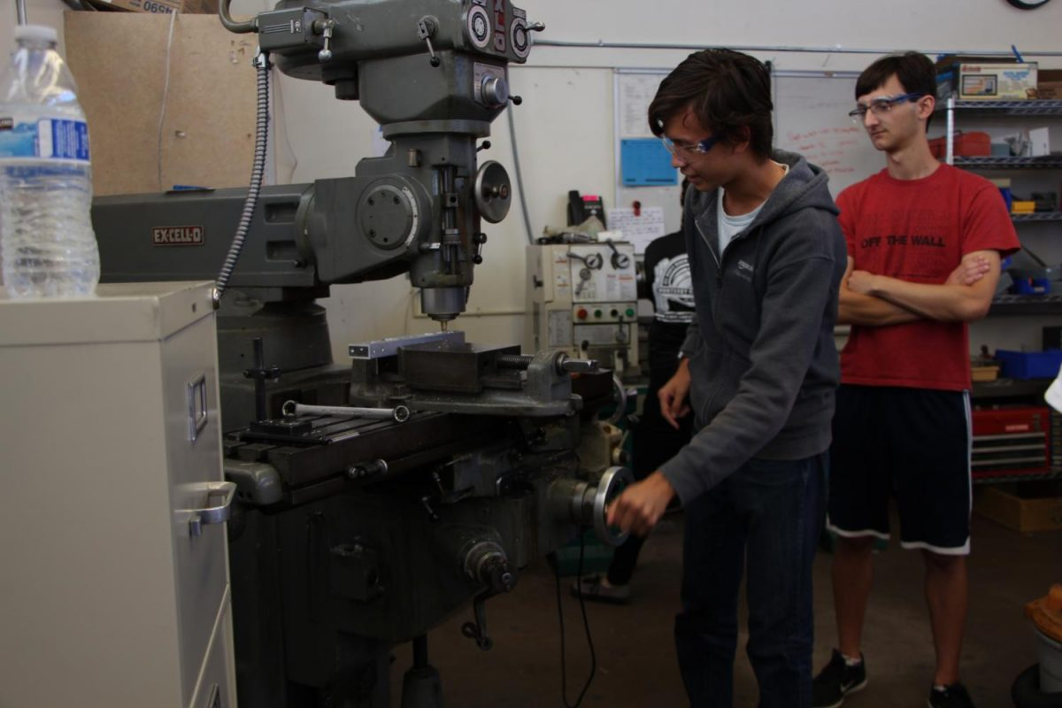 Robotics+team+member+junior+Oscar+Bjorkman+works+with+a+mill%2C+a+highly+precise+machine+that+drills+holes+and+cuts+materials+like+metal+and+plastic+to+manufacture+parts.+The+team+expanded+this+year+following+their+qualification+to+nationals%2C+buying+new+machinery+and+doubling+their+class+size.+Photo+by+Emily+Aronovitz.