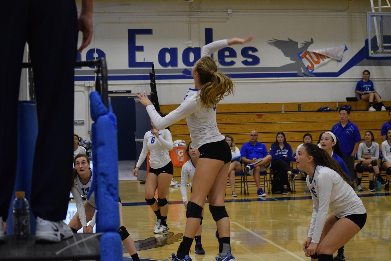 Hanadi jumps up to spike the ball down.