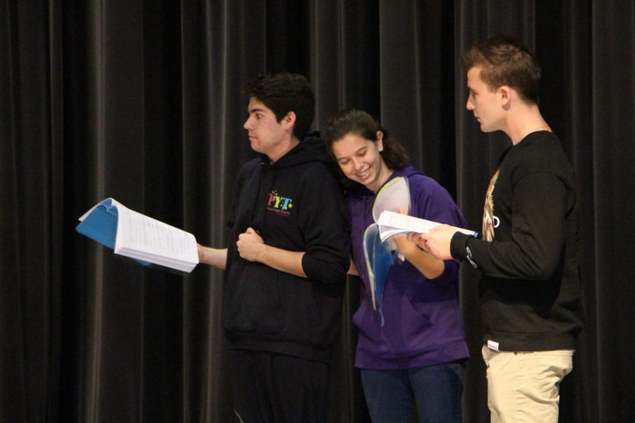 """Broken Box members, from left to right, Braden Koch, Jessica Aaron and Jake Jacobsen rehearse a scene from their upcoming play, """"The Lonely Hearts Club."""" The cast spends seven weeks to prepare for each of their plays in  order to fully thresh out their characters and settings."""