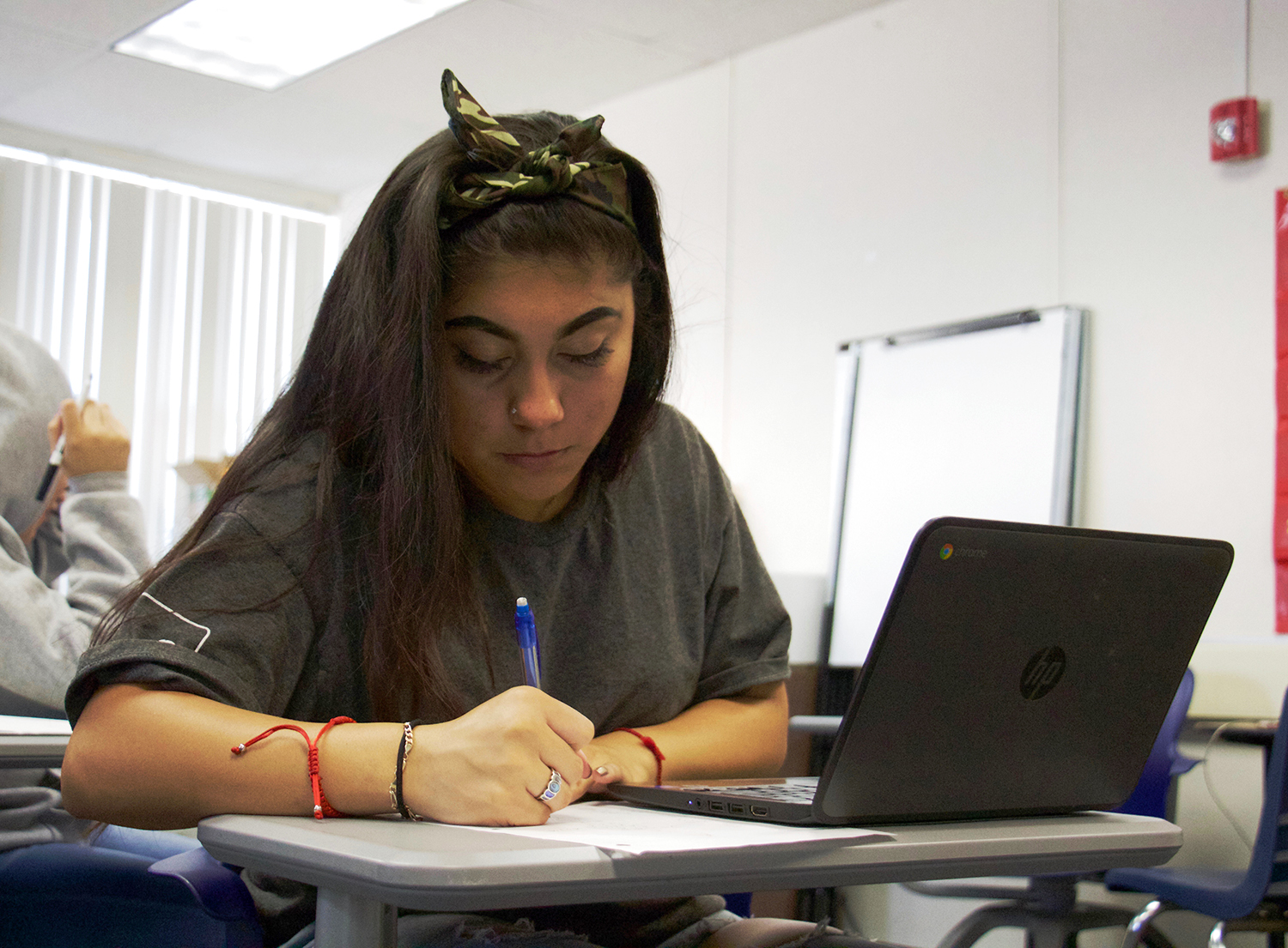 Senior Cristal Acevedo Erostico works on a math problem in Essential Math Concepts. The individually paced course, designed to prepare students for the placement exams required by junior colleges, also incorporates lessons on resiliency and financial literacy into its curriculum. Katrina Arsky.