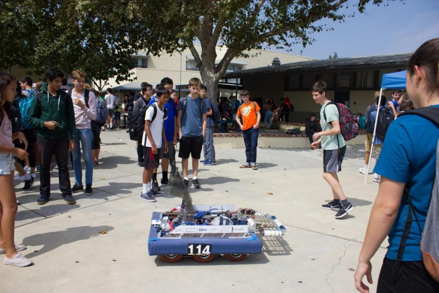 The Robotics Team shows off one of its robots at Club Day.  Robotics, along with other STEM courses and clubs, will present what they do at tomorrow's STEM Fair. Talon file photo.