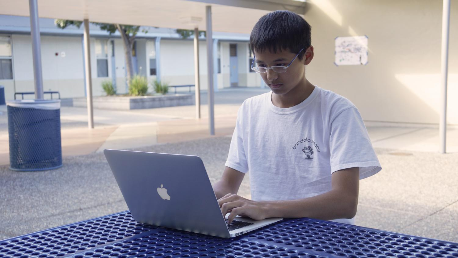Sophomore Alex Siesel works on the finances for his mom's startup company, Bandalou Baby. Since its launch, Alex has taken on the role of Director of Operations.